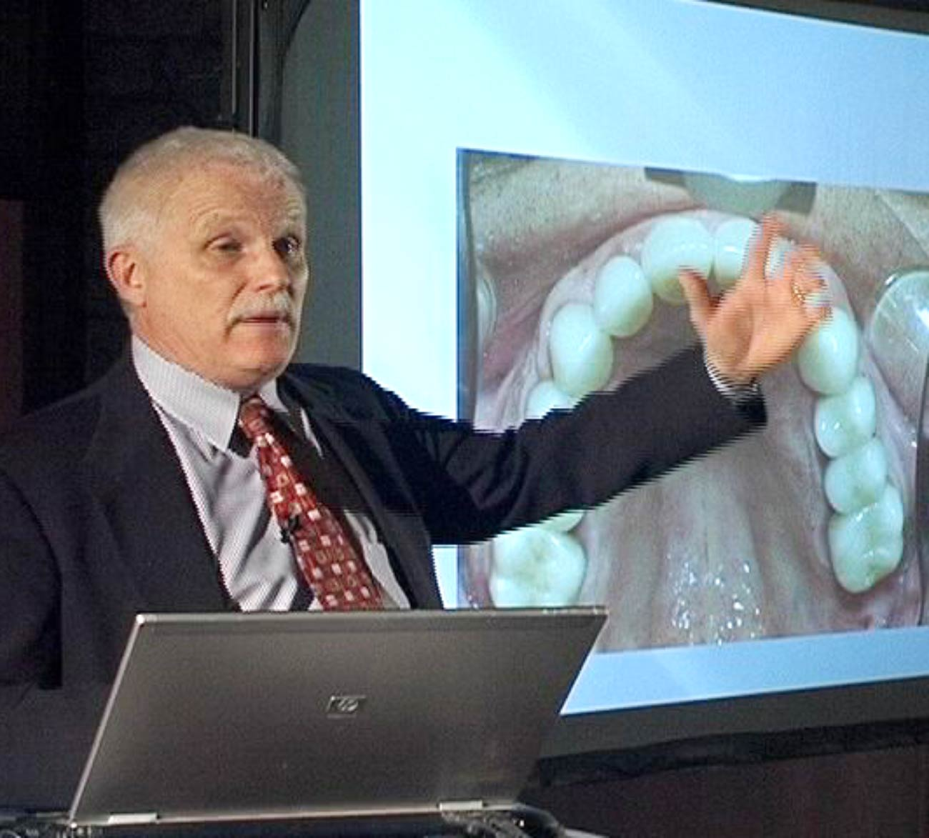 Dr. Warren Jesek speaking at a dental seminar
